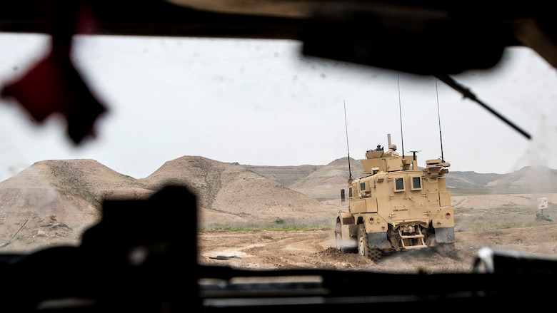 U.S. Marines with Bravo Company, 1st Battalion, 7th Marine Regiment, Special Purpose Marine Air Ground Task Force-Crisis Response-Central Command, conduct a mounted patrol in Al Taqaddum, Iraq, Jan. 1, 2016. U.S. Marines with SPMAGTF-CR-CC are responsible for the force protection of some Combined Joint Task Force – Operation Inherent Resolve bases within the U.S. Central Command area of responsibility.