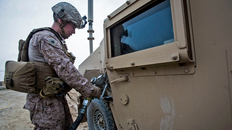Cpl. Michi Araki, a rifleman with Bravo Company, 1st Battalion, 7th Marine Regiment, Special Purpose Marine Air Ground Task Force-Crisis Response-Central Command, prepares a Humvee prior to conducting a mounted patrol in Al Taqaddum, Iraq, Jan. 1, 2016. U.S. Marines with SPMAGTF-CR-CC are responsible for the force protection of some Combined Joint Task Force – Operation Inherent Resolve bases within the U.S. Central Command area of responsibility.