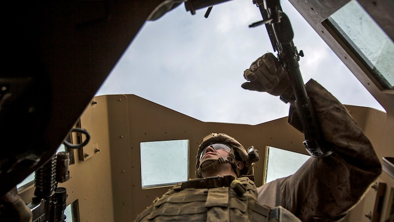 Lance Cpl. Andrew Metler, a mortarman with Bravo Company, 1st Battalion, 7th Marine Regiment, Special Purpose Marine Air Ground Task Force-Crisis Response-Central Command, mans the turret gun of a Humvee during a patrol in Al Taqaddum, Iraq, Jan. 1, 2016. U.S. Marines with SPMAGTF-CR-CC are responsible for the force protection of some Combined Joint Task Force – Operation Inherent Resolve bases within the U.S. Central Command area of responsibility.