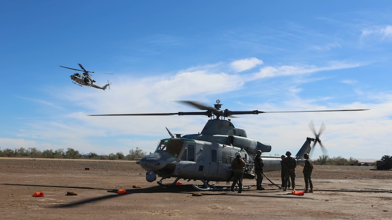 Marines with Marine Light Attack Helicopter Squadron 267 land a UH-1Y Huey to refuel during exercise Scorpion Fire 1-16 on Navy Air Facility El Centro, Calif., Jan. 25, 2016. HMLA-267 supported the exercise with close air support and live-fire capabilities, Jan. 25 to Feb. 5, 2016.