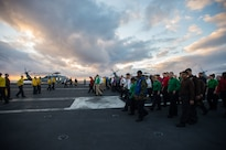 Sailors participate in a foreign object debris walk down on the USS John C. Stennis flight deck in the Pacific Ocean, Jan. 28, 2016. Navy photo by Seaman Cole C. Pielop
