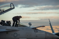Navy Seaman Danny Genao cleans the canopy of an F/A18E Super Hornet assigned to the Black Aces of Strike Fighter Squadron 41 on the flight deck of the USS John C. Stennis in the Pacific Ocean, Jan. 28, 2016. Genao is an airman. Navy photo by Seaman Cole C. Pielop