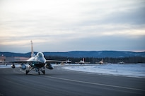 An Air Force F-16 Fighting Falcon aircraft taxi to the flightline on Eielson Air Force Base, Alaska, Jan. 24, 2016, to fly to Kadena Air Base, Japan, to participate in training exercises. The pilots are assigned to the 18th Aggressor Squadron. Air Force photo by Staff Sgt. Shawn Nickel