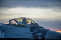 Air Force Capt. Todd Possemato taxis an F-16 Fighting Falcon aircraft to the flightline on Eielson Air Force Base, Alaska, Jan. 24, 2016, to fly to Kadena Air Base, Japan, to participate in training exercises. Possemato is a pilot assigned to the 18th Aggressor Squadron. Air Force photo by Staff Sgt. Shawn Nickel