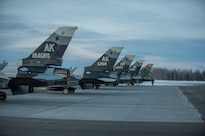 Air Force F-16 Fighting Falcon aircraft prepare to take off from Eielson Air Force Base, Alaska, Jan. 24, 2016, to fly to Kadena Air Base, Japan, to participate in training exercises. Air Force photo by Staff Sgt. Shawn Nickel
