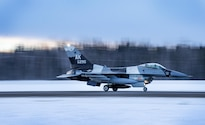 An Air Force F-16 Fighting Falcon aircraft takes off from Eielson Air Force Base, Alaska, Jan. 24, 2016 to fly to Kadena Air Base, Japan to participate in training exercises. Air Force photo by Staff Sgt. Shawn Nickel