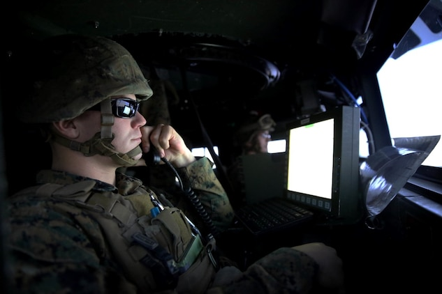 A Marine with 5th Battalion, 11th Marine Regiment, 1st Marine Division, establishes communications with the combat operation center in a Combat Convoy Simulator aboard Marine Corps Base Camp Pendleton, Feb. 2, 2016. The CCS at first glance looks like an expensive, high-tech video game, but its primary use is preparing Marines for real-world combat missions with simulations of realistic scenarios.