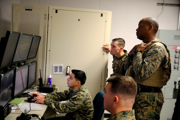 Marines with 5th Battalion, 11th Marine Regiment, 1st Marine Division, coordinate obstacles for the Marines to face in a Combat Convoy Simulator, aboard Marine Corps Base Camp Pendleton, Feb. 2, 2016. The CCS at first glance looks like an expensive, high-tech video game, but its primary use is preparing Marines for real-world combat missions with simulations of realistic scenarios.