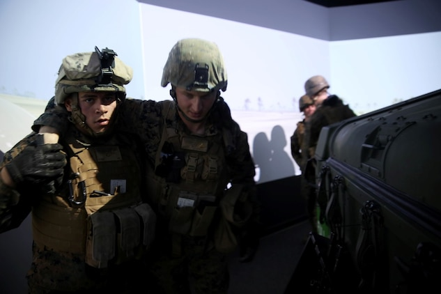 Marines with 5th Battalion, 11th Marine Regiment, 1st Marine Division, carry Marines to their designated vehicle in a Combat Convoy Simulator aboard Marine Corps Base Camp Pendleton, Feb. 2, 2016. The CCS at first glance may look like a really expensive, high-tech video game but its primary use is preparing Marines for real-world combat missions with inexpensive simulations of realistic scenarios.