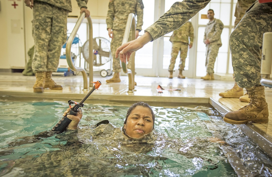 U.S. Army Reserve Officers' Training Corps cadet Victoria Wilson, 18, a freshman studying mechanical engineering from Fayetteville, N.C., completes the 15-meter swim portion of the Combat Water Survival Test, Jan. 28, 2016. (U.S. Army photo by Staff Sgt. Ken Scar)