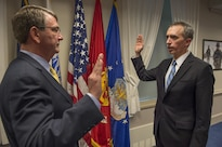 Defense Secretary Ash Carter, left, swears in Marcel Lettre as the undersecretary of defense for intelligence during a ceremony at the Pentagon, Feb. 5, 2016. Confirmed by the Senate in December 2015, Lettre serves as the principal intelligence advisory to the secretary, and exercises authority over all Defense Department intelligence and security organizations. Lettre also oversees 110,000 personnel as well as defense intelligence components, including the Military Intelligence Program, the defense portion of the National Intelligence Program and intelligence interests within the Battlespace Awareness portfolio. He is the department's principal contact for the CIA, and represents the department on intelligence and sensitive operations at the National Security Council. DoD photo by Senior Master Sgt. Adrian Cadiz