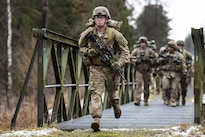 Army Spc. Shane Rader runs during a 12-mile ruck march as part of the testing phase for the expert infantryman badge at the 7th Army Joint Multinational Training Command's Grafenwoehr Training Area, Germany, Feb. 5, 2016. Bader is a paratrooper assigned to Company C, 2nd Battalion, 503rd Infantry Regiment, 173rd Airborne Brigade, The brigade provides rapidly deploying forces to the U.S. Army Europe, Africa and Central Command areas of responsibility within 18 hours. Army photo by Gertrud Zach/released)
