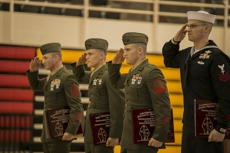 The Marine and sailor awardees salute Maj. Gen. Brian D. Beaudreault, the commanding general of 2nd Marine Division, after receiving awards for outstanding leadership at the 2nd Marine Division battle streamer rededication and award ceremony at Camp Lejeune, N.C., Feb. 5, 2016. The ceremony highlighted for a new generation of Marines the heroism, courageousness and legacy of 2nd Marine Division. (U.S. Marine Corps photo by Lance Cpl. Luke Hoogendam/Released)