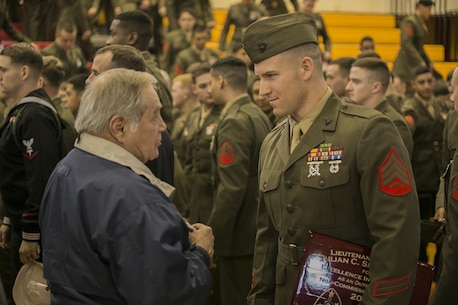 Sgt. John J. Cohee, a noncommissioned officer with 2nd Battalion, 8th Marine Regiment, talks to a veteran who served with the 2nd Marine Division after receiving an award for outstanding leadership at Camp Lejeune, N.C., Feb 5, 2016. The ceremony celebrated the traditions and legacy of the 2nd Marine Division and reinforced the bond between the Marines of wars past and a new generation of Marines. (U.S. Marine Corps photo by Lance Cpl. Luke Hoogendam/Released)
