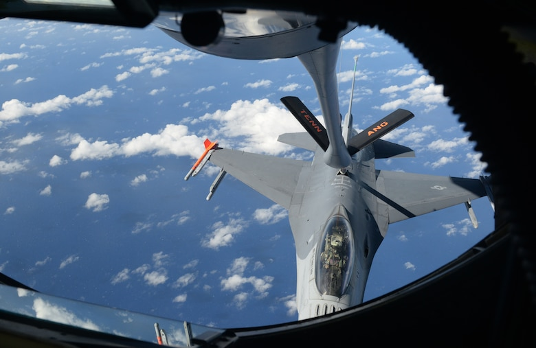 A F-16 Fighting Falcon, piloted by Maj. Curtis Voltz, 112th Expeditionary Fighter Squadron, Ohio Air National Guard chief of weapons and tactics, receives fuel from a 134th Air Refueling Wing, Tennessee ANG KC-135 Stratotanker, Feb. 2, 2016, over the Pacific Ocean. Deployed here as part of the Theater Security Package, the 112th EFS provides combat fighter assets to augment forces already operating in the Pacific theater. (U.S. Air Force photo/Senior Airman Joshua Smoot)