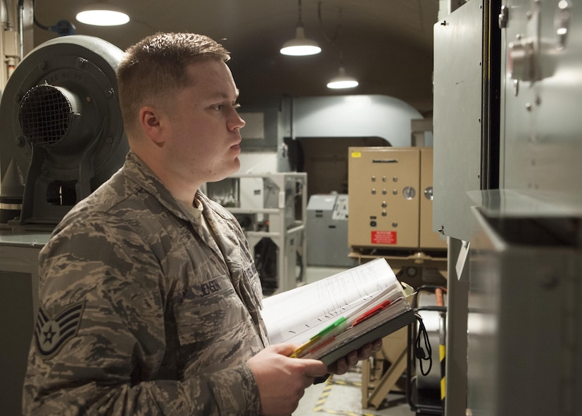Staff Sgt. Jerimiah Jensen, 320th Missile Squadron facility manager, conducts a routine maintenance check in the launch control equipment building of a missile alert facility belonging to F.E. Warren Air Force Base, Jan. 28, 2016. Facility managers  keep missile alert facilities in operation order for the nuclear deterrent mission. (U.S. Air Force photo by Lan Kim)
