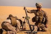 U.S. Marine Corps Cpl. Austin Miranda, mortarman, with Charlie Company, 1st Battalion 7th Marine Regiment, Special Purpose Marine Air-Ground Task Force-Crisis Response-Central Command, loads a 60mm mortar round during exercise Eager Centaur in an undisclosed location, Southwest Asia, Feb. 2, 2016. Eager Centaur is conducted to complete initial joint terminal attack controller training and exercise the MAGTF Fire Support Coordination Center, to include combined arms live fire tactics, techniques and procedures.