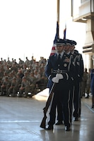 Dyess honor guardsmen present the colors at a 7th Bomb Wing change of command ceremony Oct. 29, 2015, at Dyess Air Force Base, Texas.  The honor guard participates in many events, including retirement and change of command ceremonies, funeral services and parades. (U.S. Air Force photo by Airman Quay Drawdy/ Released)