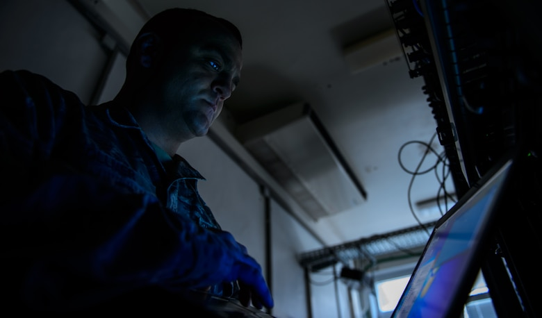 Tech. Sgt. Randal Collmer, 1st Communications Maintenance Squadron infrastructure theater maintenance section chief, demonstrates network maintenance at Kapaun Military Complex, Germany, Jan. 8, 2016. The 1st CMXS and the 86th Communications Squadron teamed up at the first few months of 2016 to improve and strengthen Ramstein's cyber network. (U.S. Air Force photo/Staff Sgt. Armando A. Schwier-Morales)