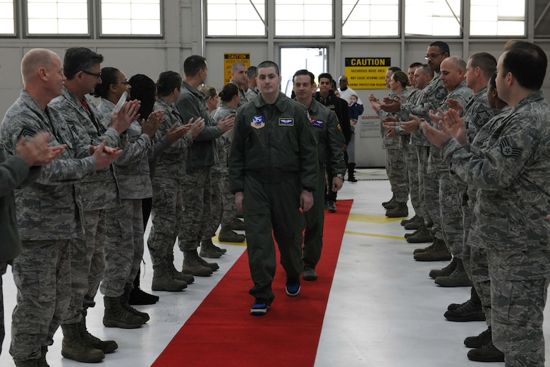 Michael Oliver, Pilot for a Day participant, is greeted by Airmen from the 113th Maintenance Group at Joint Base Andrews, Md., Feb. 5, 2016. Oliver, diagnosed with Erdheim-Chester Disease, a disease with no known cure, experienced what it is like to be a pilot for a day along with friends and family. The day included touring an assortment of aircraft including an F-16 Fighting Falcon, KC-135 Stratotanker and a UH-1N Huey helicopter. (U.S. Air Force photo by Senior Airman Dylan Nuckolls/Released)