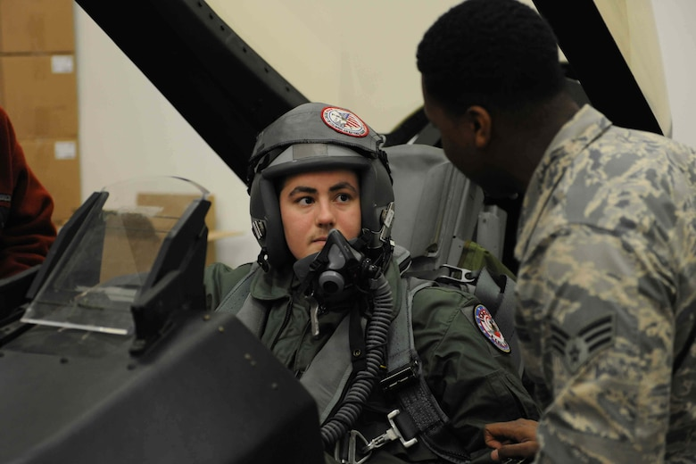 Michael Oliver, Pilot for a Day participant, receives an F-16 Fighting Falcon fighter aircraft safety briefing from a 113th Operation Support Squadron, aircrew flight technician at Joint Base Andrews, Md., Feb. 5, 2016. Oliver, diagnosed with Erdheim-Chester Disease, a disease with no known cure, experienced what it is like to be a pilot for a day along with friends and family. The day included touring an assortment of aircraft including an F-16 Fighting Falcon, KC-135 Stratotanker and a UH-1N Huey helicopter. (U.S. Air Force photo by Senior Airman Dylan Nuckolls/Released)