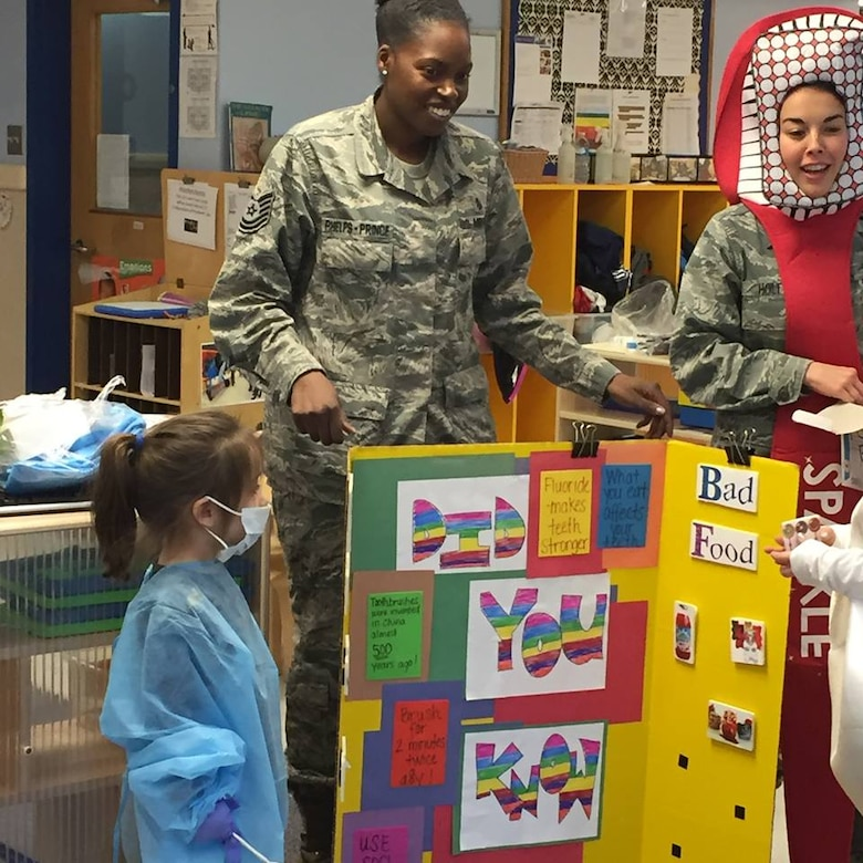 On Feb. 5, members of the Dental Squadron from the 779th Medical Group went to the Child Development Center on Joint Base Andrews to teach the kids about good dental health. They played a game to match good foods versus bad foods. (AF photo by Melanie Moore/Released)