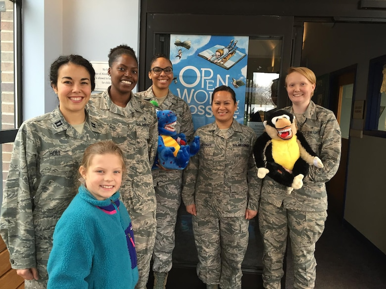 On Feb. 5, members of the Dental Squadron from the 779th Medical Group went to the Child Development Center on Joint Base Andrews to teach the kids about good dental health. From left to right are: Captain (Dr.) Melissa Holt, Air Force dentist and her daughter Samantha; Tech. Sgt. Tina Phelps-Prince, NCOIC for preventive dentistry; Senior Airman Kira Davis, dental technician; Master Sgt. Millicent Cavazos, dental hygienist; and Airman 1st Class Elizabeth Smith, dental assistant. (AF photo by Melanie Moore/Released)