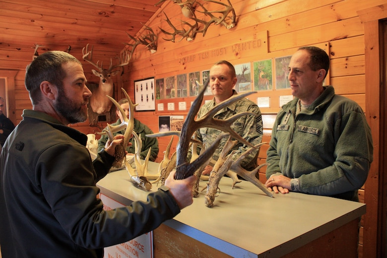 Ryan Toby, chief of the Land Management Office at McAlester Army Ammunition Plant, talks to Lt. Gen. Lee K. Levy II, commander, Air Force Sustainment Center at Tinker Air Force Base, Okla., and Chief Master Sgt. Jason France about the growth of antlers from a large buck on the plant in southeastern Oklahoma during a visit for the base, Jan. 11. (U.S. Army photo by Kevin Jackson)
