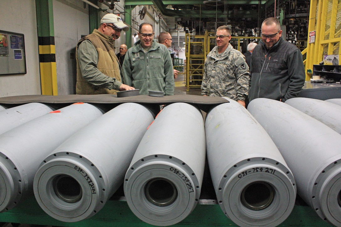 Jerry Lovell (left), A-Line bombs and mines supervisor, talks to Lt. Gen. Lee K. Levy II (second from left), commander, Air Force Sustainment Center at Tinker Air Force Base, Okla., about general purpose bomb preparation during a visit to McAlester Army Ammunition Plant, Okla., Jan. 11. Col. Sean M. Herron, MCAAP commander, and Bill Tollett, director of Ammunition Operations, also listen intently. (U.S. Army photo by Kevin Jackson)