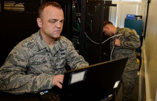 Air Force Tech. Sgt. Randal Collmer, 1st Communications Maintenance Squadron infrastructure theater maintenance section chief, and Air Force Staff Sgt. Bradley Anderson, 1st CMXS special communications maintenance technician, work to test their training network at Kapaun Military Complex, Germany, Jan. 8, 2016. The 1st CMXS supports bases around Europe by working side by side to improve and optimize the bases networks. The Defense Department is launching a pilot program to allow vetted computer security specialists to do their best to hack DoD public Web pages. Air Force photo by Staff Sgt. Armando A. Schwier-Morales
