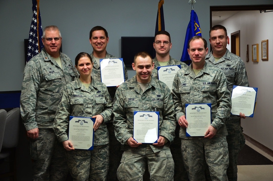 Six Airmen from the 157th Communications Flight were presented with achievement medals for their performance during a power outage experienced during the January unit training assembly, Pease Air National Guard Base, N.H. (U.S. Air National Guard photo by Senior Airman Kayla McWalter)