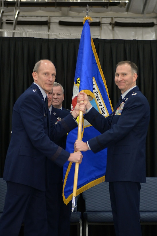 The New Hampshire Adjutant General Maj. Gen. William N. Reddel III passes the wing colors to Col. James Ryan during a change of command ceremony, Feb. 7, 2016, Pease Air National Guard Base, New Hampshire. The event was attended by the Governor of New Hampshire the Honorable Maggie Hassan, and Airmen both past and present. This ceremony signified command of the 157th Air Refueling Wing changing from Col. Shawn R. Burrus to Ryan. (U.S. Air National Guard photo by Airman 1st Class Ashlyn J. Correia)