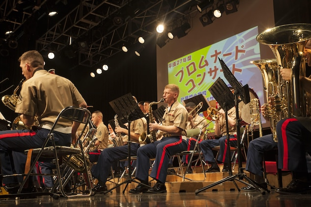 Marines with the III Marine Expeditionary Force Band performs at Koza Music Town, Okinawa City, Okinawa, Japan, for the Okinawa Promenade Concert Feb. 6, 2016. The Marines played as the finale for the concert following the Kubasaki High School Band.