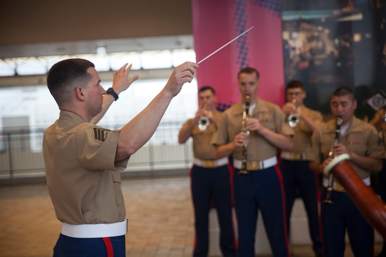 Marines with the III Marine Expeditionary Force Band practice before performing at the Koza Music Town, Okinawa City, Okinawa, Japan, for the Okinawa City Promenade Concert Feb. 6, 2016. The III MEF Band was the final performance following the Kubasaki High School Band.