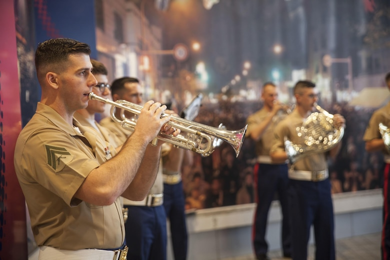Marines with the III Marine Expeditionary Force Band perform at the Koza Music Town, Okinawa City, Okinawa, Japan, for the Okinawa City Promenade Concert Feb. 6, 2016. The III MEF Band was the final performance following the Kubasaki High School Band.