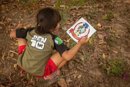 A child holds an exercise Cobra Gold 2016 sticker in Lop Buri, Thailand, exercise Cobra Gold, Jan. 23, 2016. Cobra Gold 2016, in its 35th iteration, includes a specific focus on humanitarian civic action, community engagement and medical activities conducted during the exercise to support the needs and humanitarian interests of civilian populations around the region.