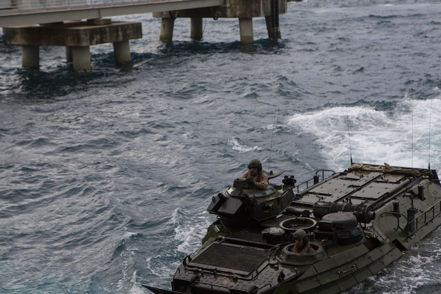Marines with Alpha Company, Battalion Landing Team 1st Battalion, 5th Marines, 31st Marine Expeditionary Unit, drive their AAV-P7/A1 Amphibious Assault Vehicle toward the well-deck of the USS Ashland (LSD 48) Jan. 29, 2016, at White Beach, Okinawa, Japan. The Marines loaded their AAVs onto the Ashland before departing for the MEU's spring deployment. The spring deployment is a regularly scheduled deployment designed to support PACOM's theater security cooperation initiatives to promote goodwill, and strengthen allied relationships.