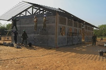 Service members from the Royal Thai Armed Forces, Malaysia Armed Forces and the U.S. Navy work together to build a community center at Ban Sa Yai School, in Trat, Thailand, during exercise Cobra Gold, Feb. 3, 2016. Cobra Gold 2016, in its 35th iteration, includes a specific focus on humanitarian civic action, community engagement and medical activities conducted during the exercise to support the needs and humanitarian interests of civilian populations around the region.