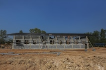 Service members from the Royal Thai Armed Forces, Malaysia Armed Forces and the U.S. Navy, work together to build a community center at the Ban Sa Yai School, in Trat, Thailand, during exercise Cobra Gold, Feb. 3, 2016. Cobra Gold 2016, in its 35th iteration, includes a specific focus on humanitarian civic action, community engagement, and medical activities conducted during the exercise to support the needs and humanitarian interests of civilian populations around the region.