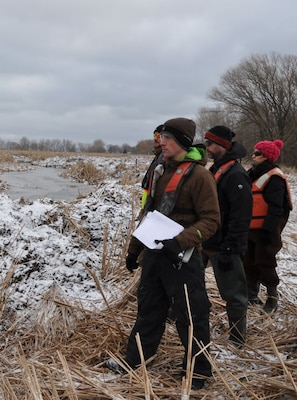 USACE Buffalo District project managers Chris Akios, Sheila Hint, and Joshua Unghire inspect newly formed channels at the Braddock Bay Wildlife Management Area, Greece, NY.