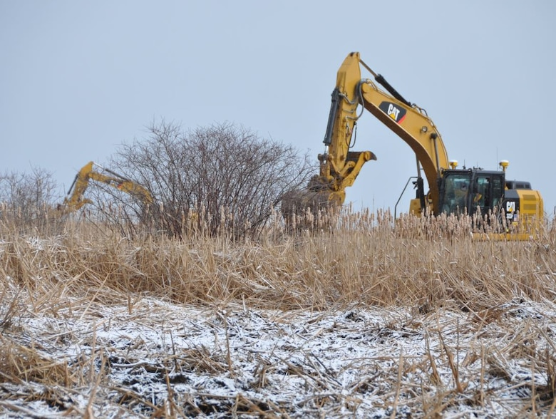 Excavators creating channels and potholes in the Braddock Bay Wildlife Management Area, Greece, NY