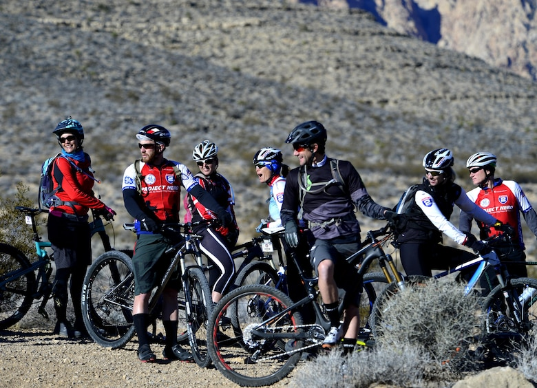 U.S. veterans participating in a Ride 2 Recovery program enjoy a laugh before starting a mountain bike ride Feb. 2, 2016, at Blue Diamond, Nev. The program is dedicated to helping wounded and recovering veterans recover from injuries sustained during their military service through biking. (U.S. Air Force photo/Senior Airman Christian Clausen)