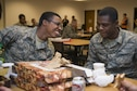 Airman Alijah Norris (left) and Airman Alante Brown (right), 366th Training Squadron students, attend a Super Bowl party at the Sheppard Air Force Base, Texas, Solid Rock Cafe. The Chapel staff served more than 400 people on Super Bowl Sunday, investing nearly $800 in their spiritual health, morale and well-being, Feb. 7, 2016. Sheppard chaplains also serve nearly 180,000 visitors annually, with the largest Airman Ministry Center in the Air Force. (U.S. Air Force photo/Senior Airman Kyle Gese)