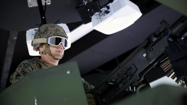 A Marine with 5th Battalion, 11th Marine Regiment, 1st Marine Division, loads an electronic M2 .50-caliber machine gun in a Combat Convoy Simulator at Marine Corps Base Camp Pendleton, California, Feb. 2, 2016. The CCS at first glance looks like an expensive, high-tech video game, but its primary use is preparing Marines for real-world combat missions with simulations of realistic scenarios.
