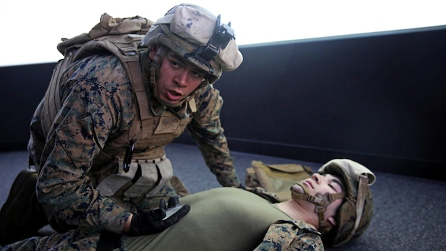 Marines with 5th Battalion, 11th Marine Regiment, 1st Marine Division, rehearse procedures for assessing and treating combat injuries in a Combat Convoy Simulator at Marine Corps Base Camp Pendleton, California, Feb. 2, 2016. The CCS at first glance looks like an expensive, high-tech video game, but its primary use is preparing Marines for real-world combat missions with simulations of realistic scenarios.