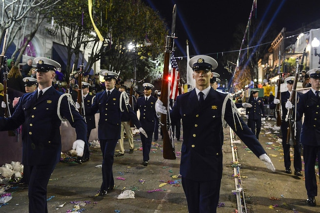 Members of the Coast Guard's ceremonial honor guard perform a rifle routine while marching during the Bacchus Mardi Gras parade in New Orleans, Feb. 7, 2016. The honor guard participates in multiple military events around the country. Coast Guard photo by Petty Officer 2nd Class Jonathan Lally