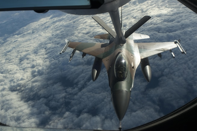 An Air Force F-16 Fighting Falcon aircraft refuels from a KC-135 Stratotanker during Forceful Tiger near Okinawa, Japan, Jan. 28, 2016. Air Force photo by Staff Sgt. Maeson L. Elleman