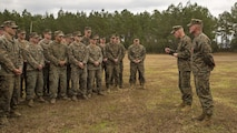 Major Gen. Brian D. Beaudreault, the commanding general of 2nd Marine Division, speaks to Marines at Marine Corps Base Camp Lejeune, North Carolina, Feb. 5, 2016, as Staff Sgt. Nathan A. Hervey, an instructor with the Advanced Infantry Training Battalion at the School of Infantry-East, looks on. Hervey was awarded the Bronze Star Medal with the combat distinguishing device for valor, and was recognized for extraordinary heroism for his actions on May 21, 2011, while carrying out his duties as a scout sniper section leader with 3rd Battalion, 2nd Marine Regiment, in support of Operation Enduring Freedom.
