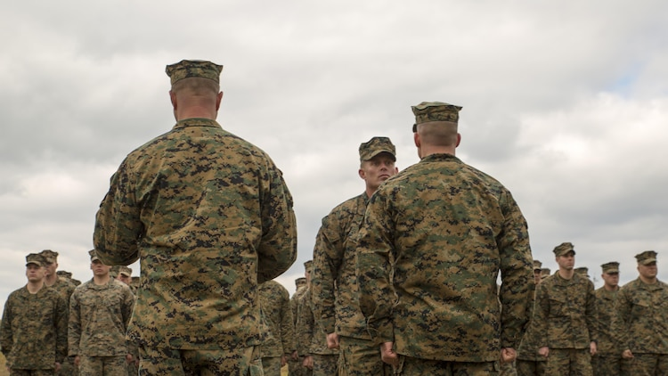 Staff Sgt. Nathan A. Hervey, an instructor with the Advanced Infantry Training Battalion at the School of Infantry-East, listens to his award citation being read at Marine Corps Base Camp Lejeune, North Carolina, Feb. 5, 2016. Hervey was awarded the Bronze Star Medal with the combat distinguishing device for valor, and was recognized for extraordinary heroism for his actions on May 21, 2011, while carrying out his duties as a scout sniper section leader with 3rd Battalion, 2nd Marine Regiment, in support of Operation Enduring Freedom.