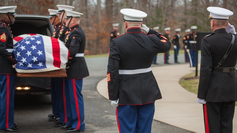 Lieutenant Gen. Jon M. Davis, right, salutes the casket of Lt. Gen. William H. Fitch (ret.) at Quantico National Cemetery, Feb. 4, 2016, in Triangle, Virginia. Fitch died Jan. 19, 2016. He served as the Deputy Commandant for Aviation before he retired in 1984 after 32 years as a Marine Corps officer.